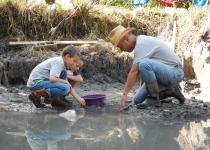 Dr. Blaine Schubert and a Saltville Dig Day participant.